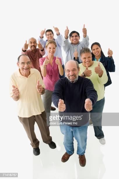 studio shot of people giving the thumbs up - honduras fotografías e imágenes de stock