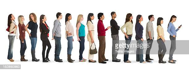 studio shot of people waiting in line - waiting stock pictures, royalty-free photos & images