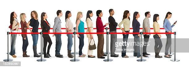 Studio shot of people waiting in line