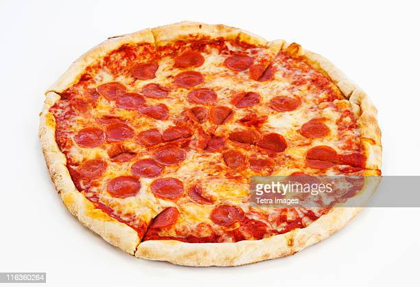 studio shot of pepperoni pizza - pepperoni pizza stock photos and pictures