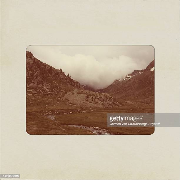 Studio shot of photograph of mountain landscape with stream