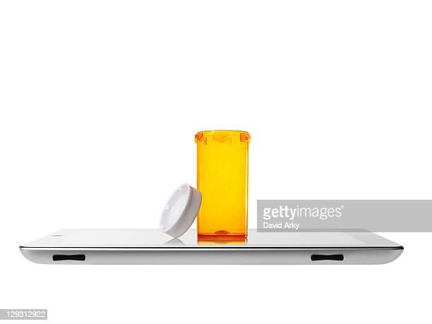 Studio shot of pill bottle on digital tablet