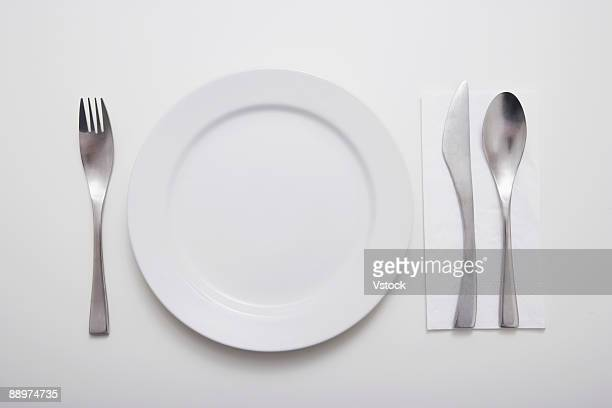 Studio shot of plate with cutlery