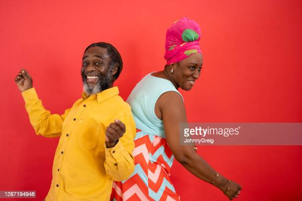 studio shot of playful black friends in 40s and 50s dancing - sleeveless dress stock pictures, royalty-free photos & images