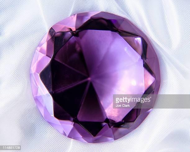 Studio shot of purple gem