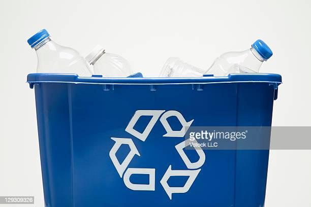 Studio shot of recycling bin with bottles