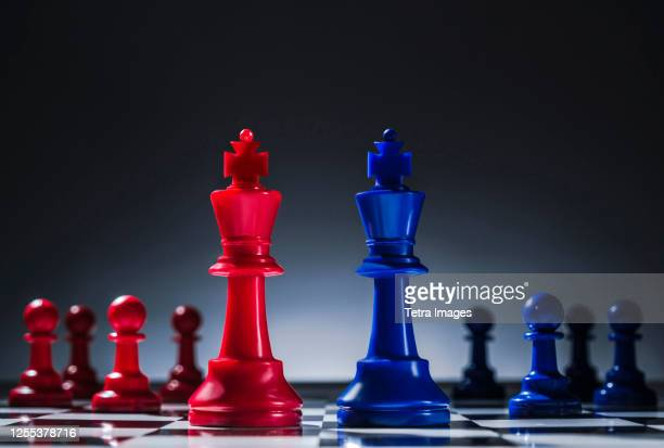 studio shot of red and blue chess pawns symbolizing us democratic and republican parties - election stock pictures, royalty-free photos & images