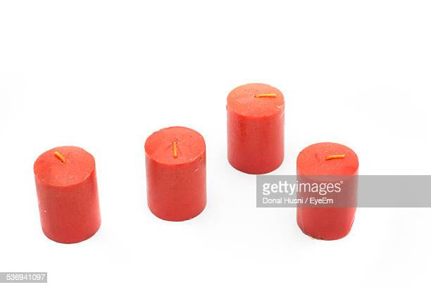 Studio Shot Of Red Candles On White Background