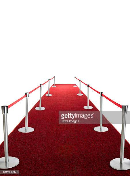 studio shot of red carpet with stanchions and velvet rope - roped off stock photos and pictures