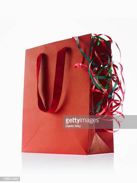 Studio shot of red gift bag with ribbons