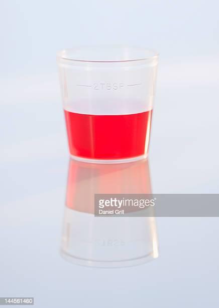 Studio shot of red medicine