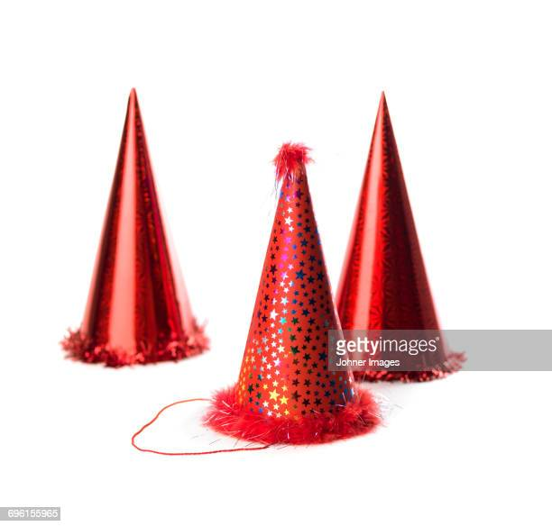 Studio shot of red party hats