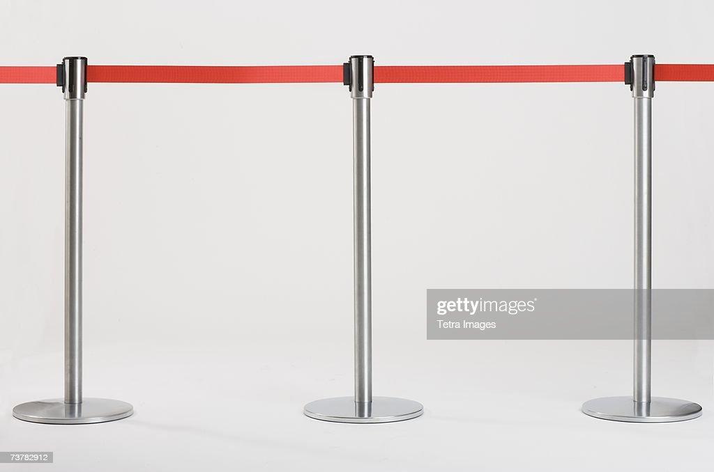 Studio shot of retractable belt crowd control barriers : Stock Photo