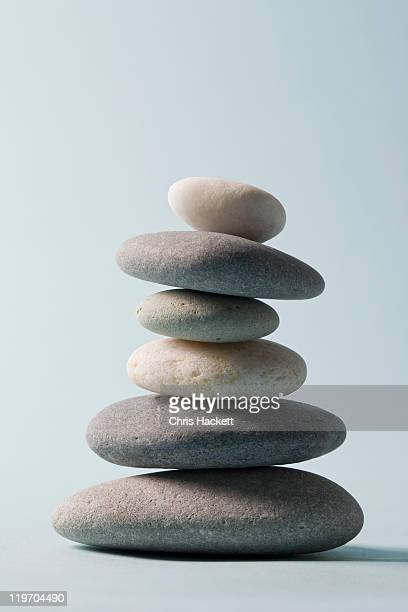studio shot of rocks balancing on one another - pebble stock pictures, royalty-free photos & images
