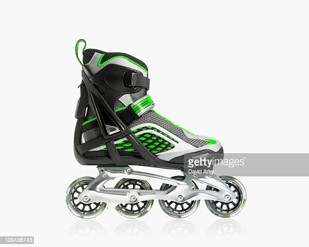 studio shot of rollerblade shoe - roller skating stock photos and pictures