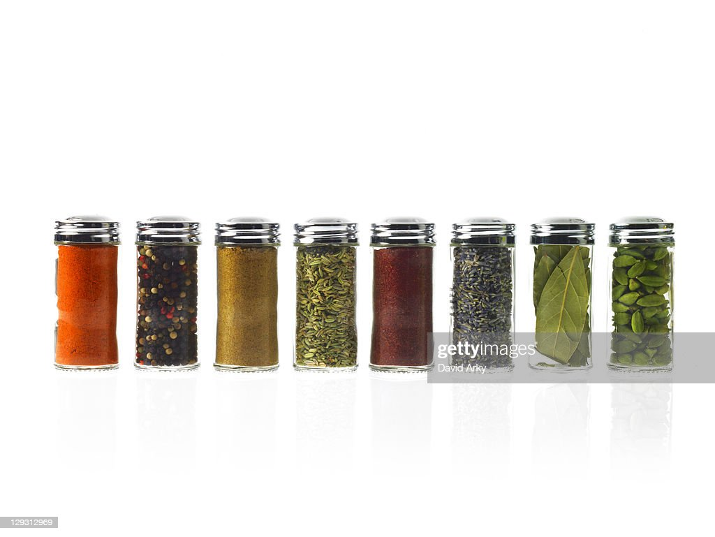 Studio shot of row of jars with spices : Stock Photo
