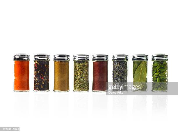 studio shot of row of jars with spices - spice stock pictures, royalty-free photos & images