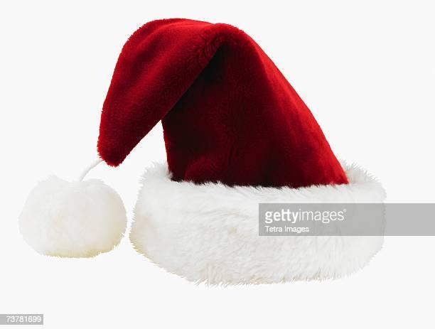 studio shot of santa claus hat - santa hat stock photos and pictures