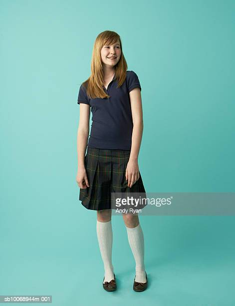 studio shot of schoolgirl (12-13) smiling - white skirt stock photos and pictures