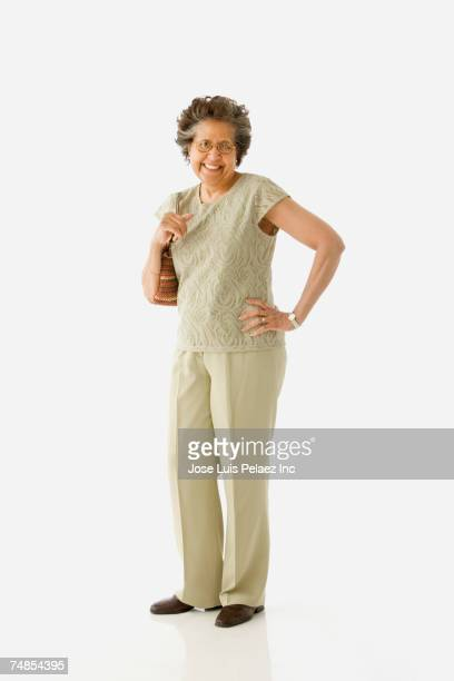 Studio shot of senior Hispanic woman with purse
