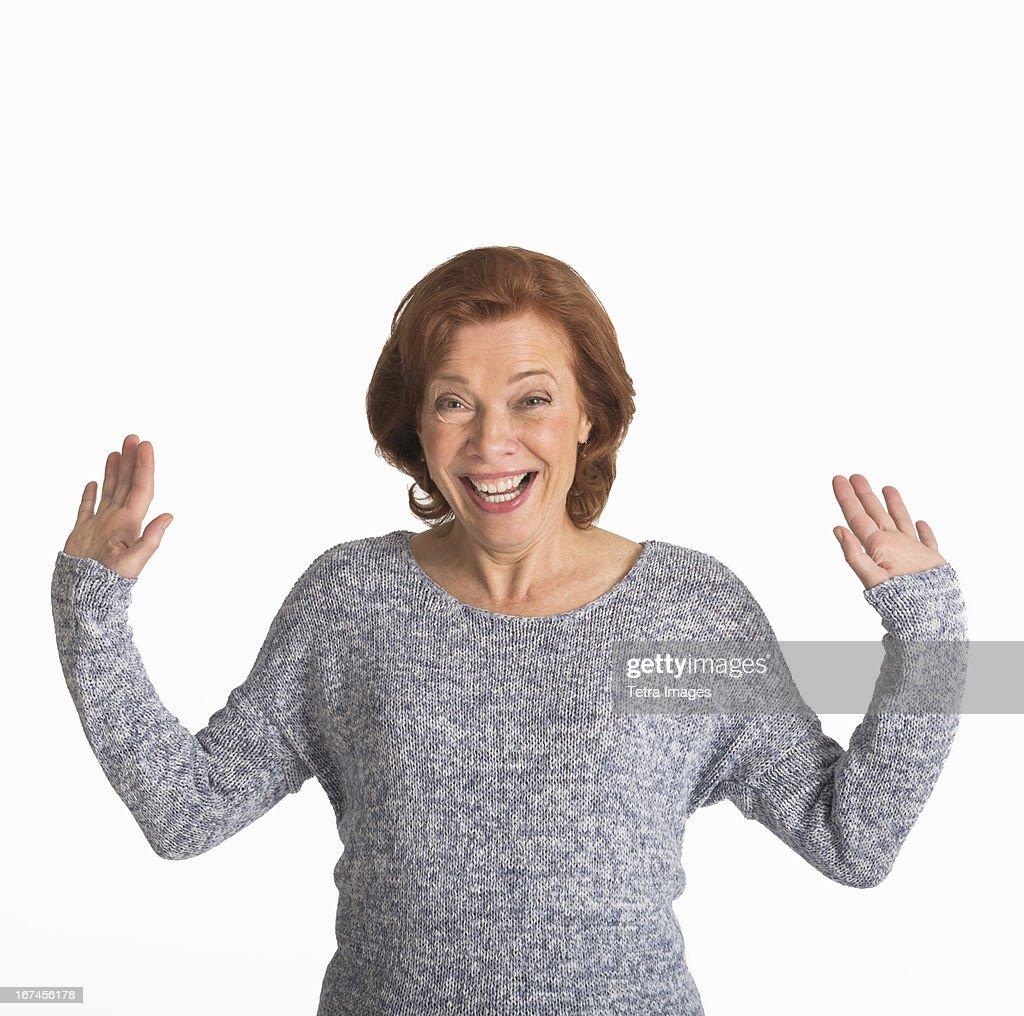 Studio shot of senior woman smiling : Stock Photo