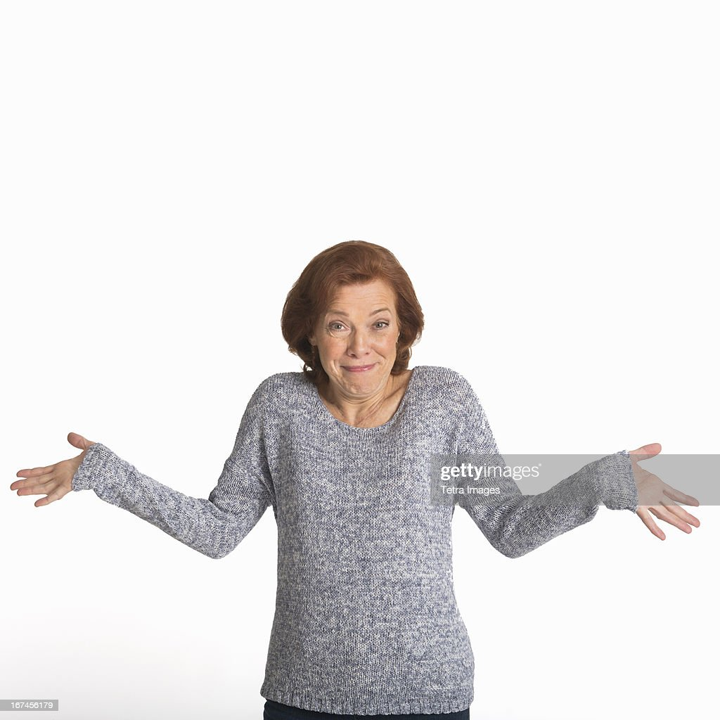 Studio shot of senior woman smiling : Stock Photo