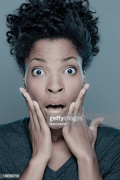 Studio shot of shocked young woman