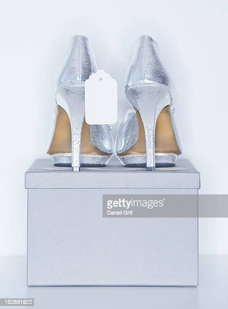 Studio shot of silver dress shoe on shoe box
