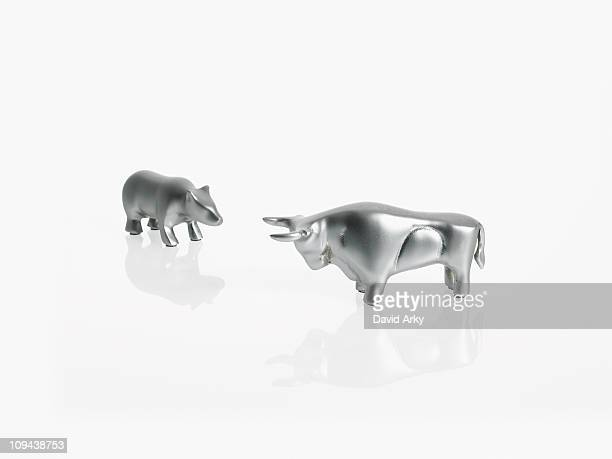 Studio shot of silver figurines of bull and bear