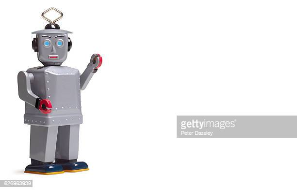 studio shot of silver robot with copy space - toy stock pictures, royalty-free photos & images