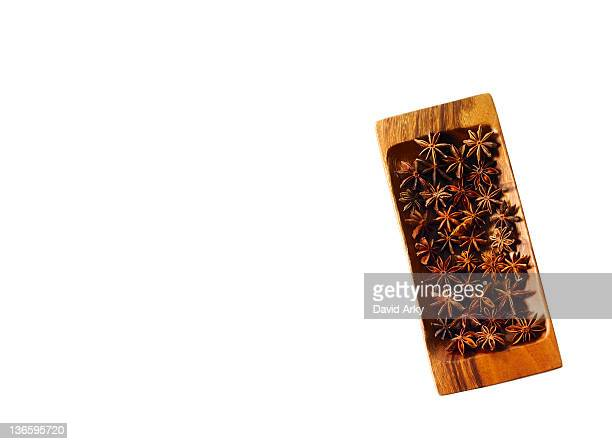 Studio shot of star anise on wooden tray