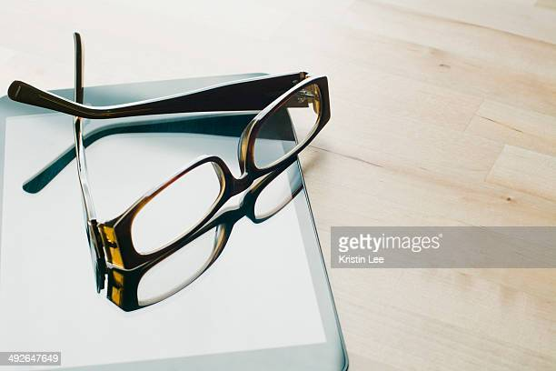 studio shot of sunglasses on tablet - things that go together stock photos and pictures