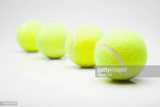Studio shot of tennis balls in row