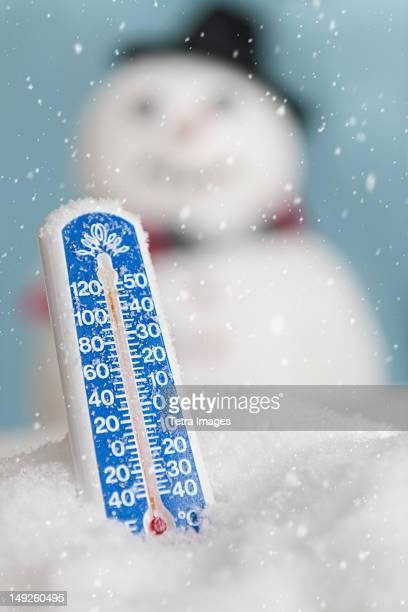 Studio shot of thermometer with snowman