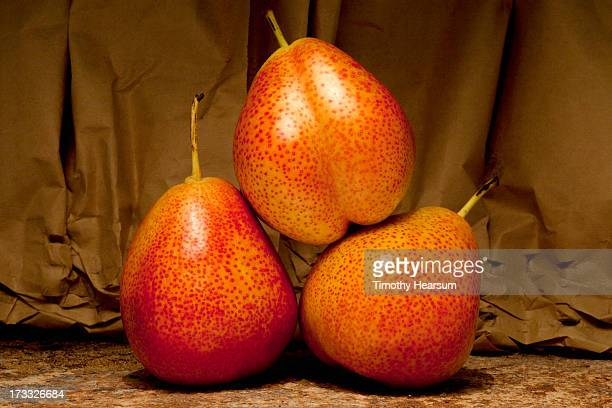 studio shot of three forelle pears - timothy hearsum stock photos and pictures