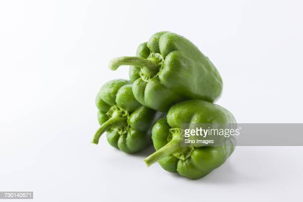 Studio shot of three green bell peppers