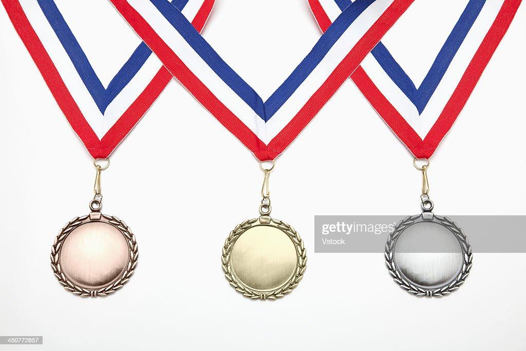 Studio shot of three medals : Stock Photo