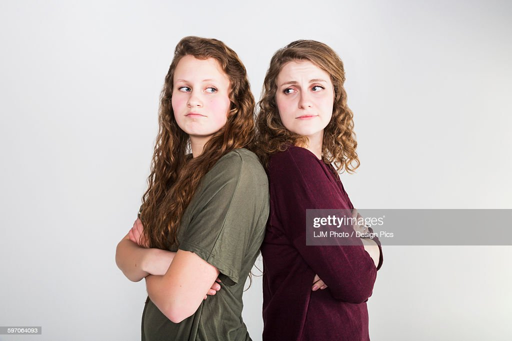 Studio shot of two girlfriends fighting, on a white background : Stock Photo