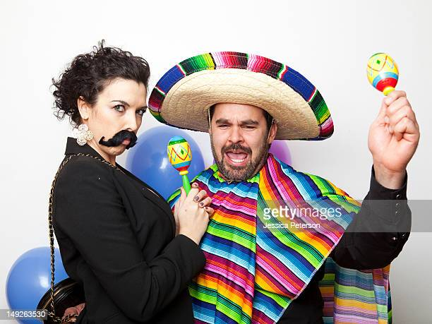 studio shot of two people dressed up as mexicans - mexican hat stock pictures, royalty-free photos & images