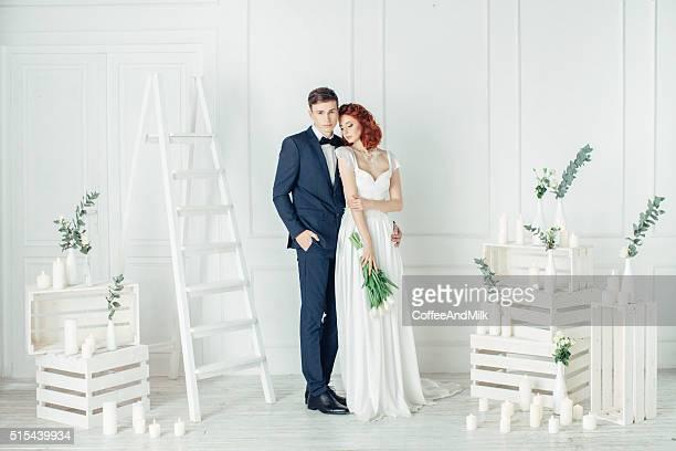 Studio shot of two young beautiful newlyweds