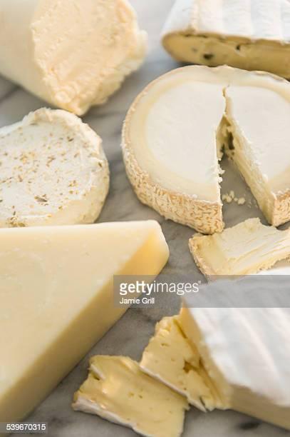 Studio shot of varied cheese slices