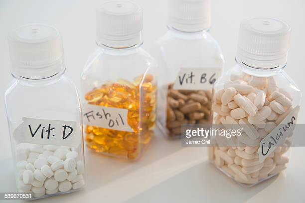 Studio shot of various pills in bottles