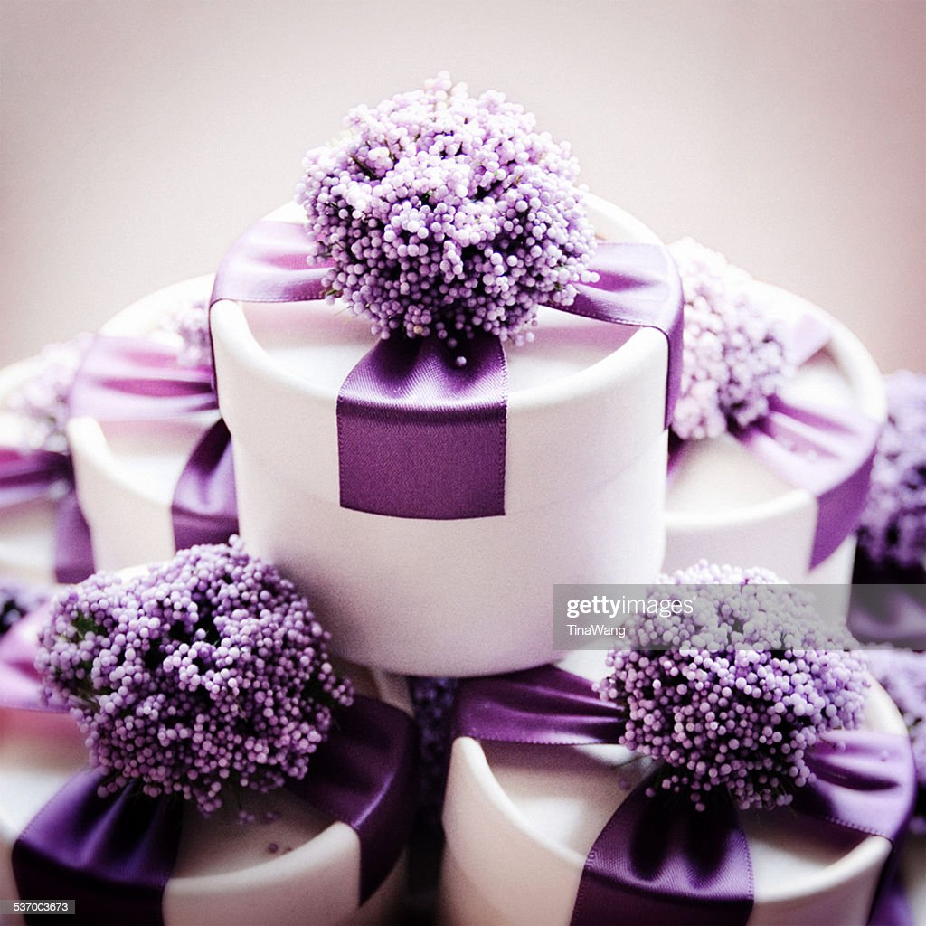 Studio shot of wedding candy boxes with purple ribbons : Stock Photo