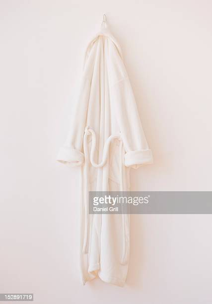 studio shot of white bathrobe - hanging stock pictures, royalty-free photos & images