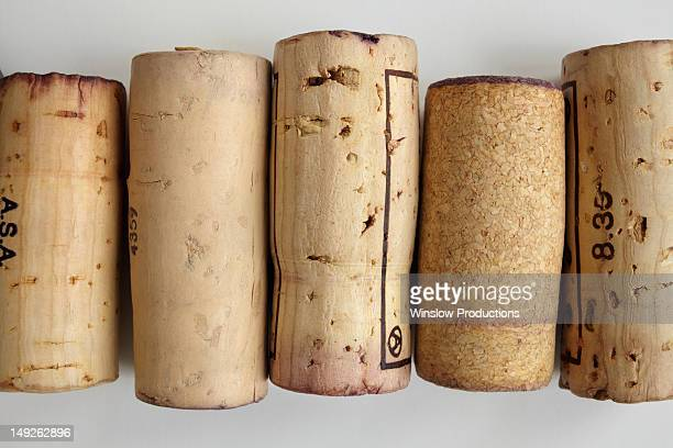 studio shot of wine corks - wine cork stock photos and pictures
