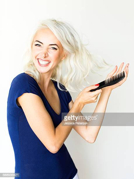 Studio shot of woman combing hair