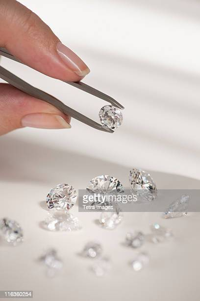Studio shot of woman holding diamonds