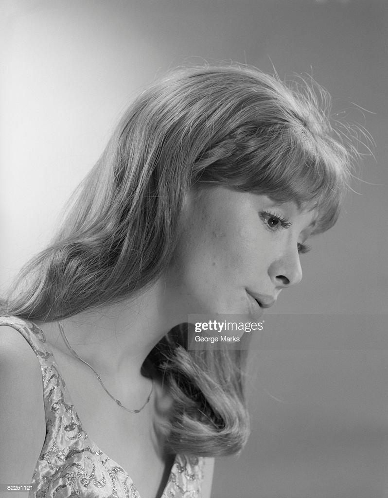 Studio shot of woman looking down : Stock Photo