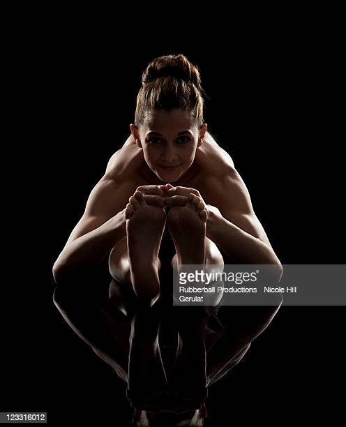 studio shot of woman practicing yoga.  westward stretch, paschimottanasana - soles pose stock pictures, royalty-free photos & images