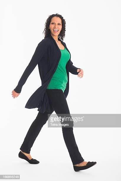 Studio shot of woman walking